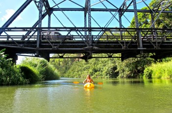Alex kayaking under the Hanalei Bridge