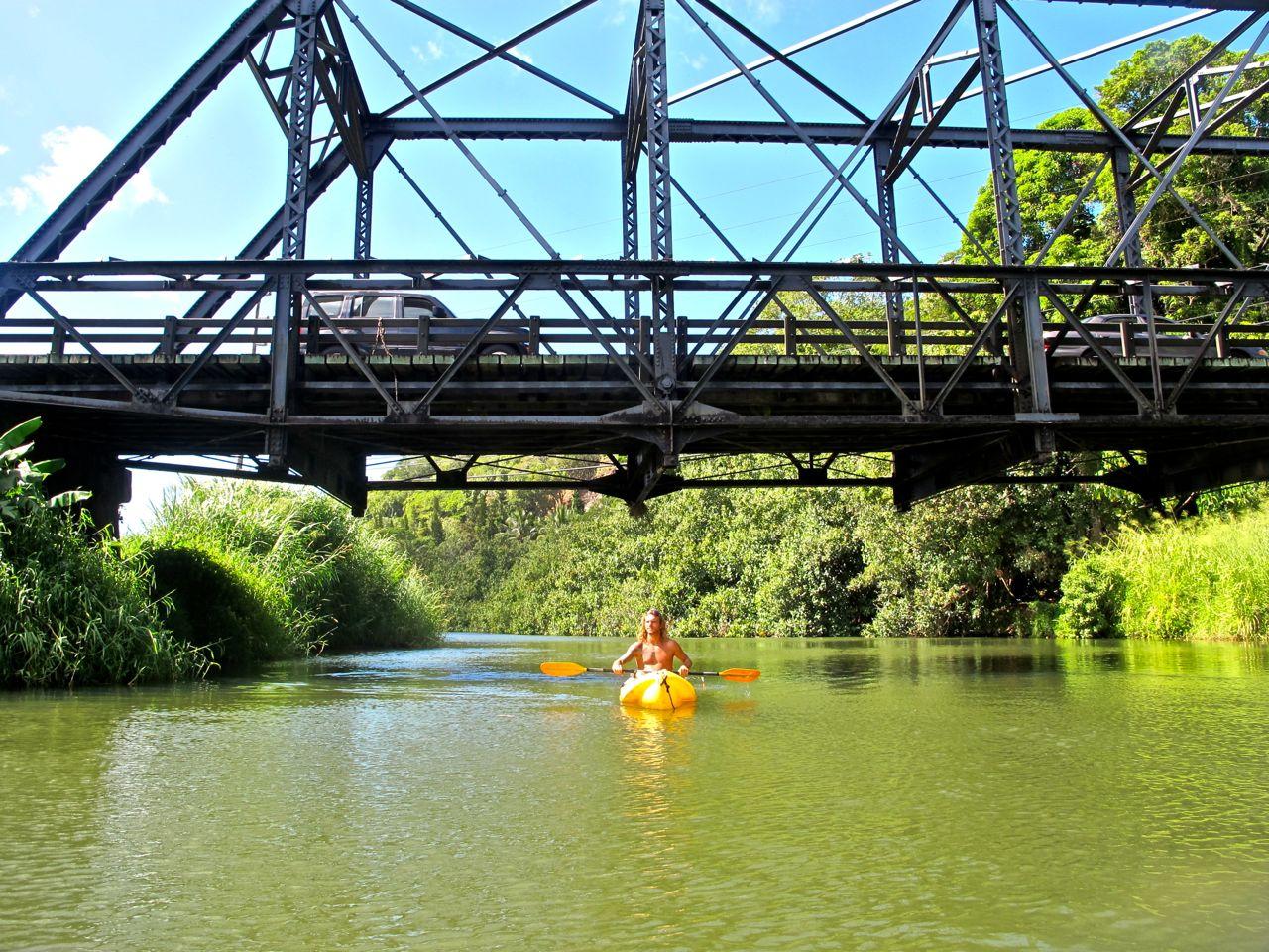 Alex kayaking under the Hanalei Bridge