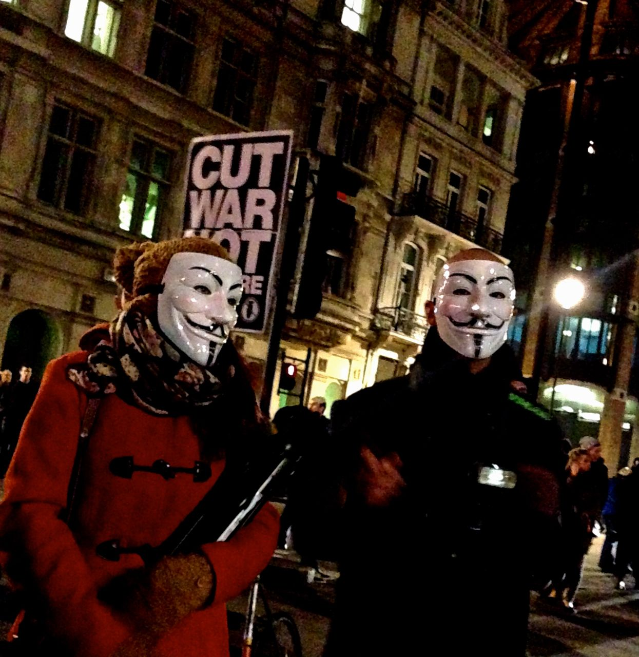 Protestors in masks gather at near Parliament on Nov. 5, 2013